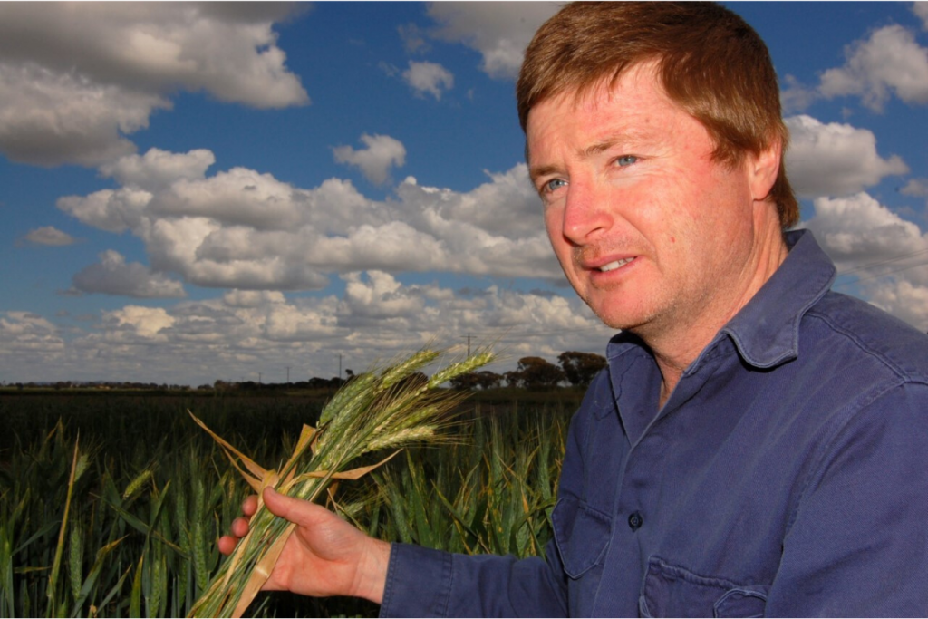 Grant Hollaway holding wheat