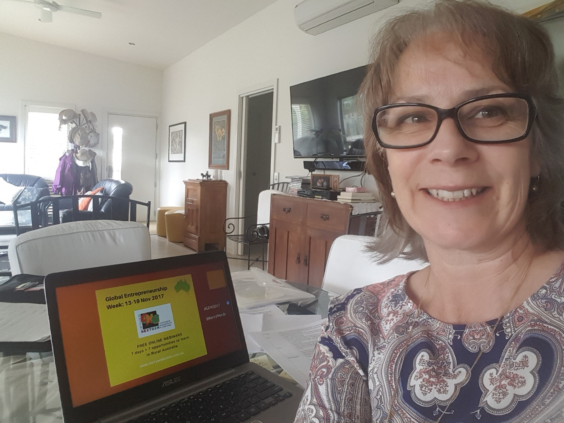 Kerry at her home with her laptop
