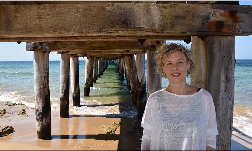 2017 Victorian AgriFutures Rural Women's Award winner Kirsten Abernethy on beach under jetty