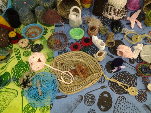 Colourful baskets woven from natural materials by Indigenous women