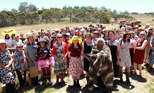 Large group of women in field attending Chicks in the Sticks event