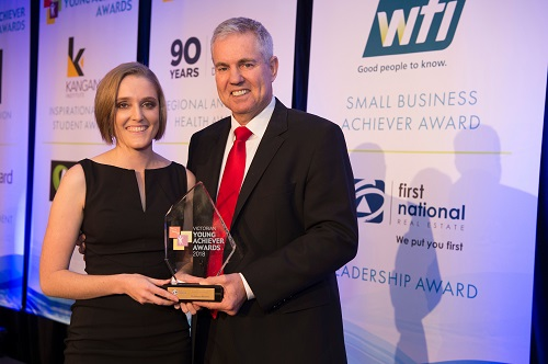 Dr Jo Newton receives a leadership award from Ray Ellis, CEO of First National Real Estate