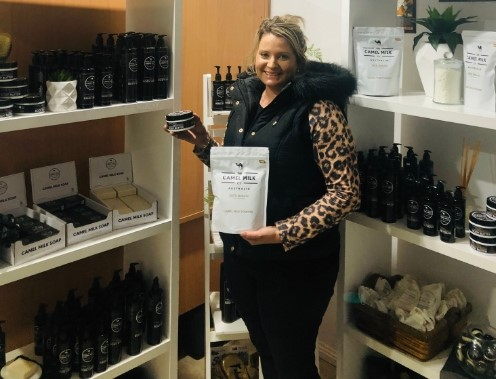 Megan Williams displays her camel milk products