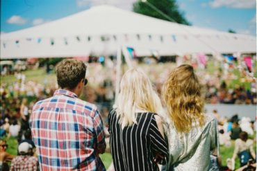 Rear view of three people at rural show