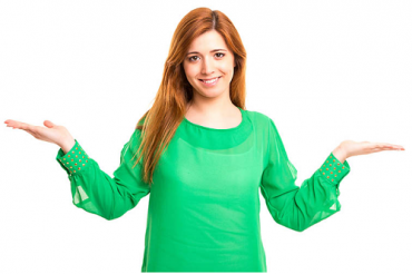 Woman in green raising hands in 'weighing up' gesture