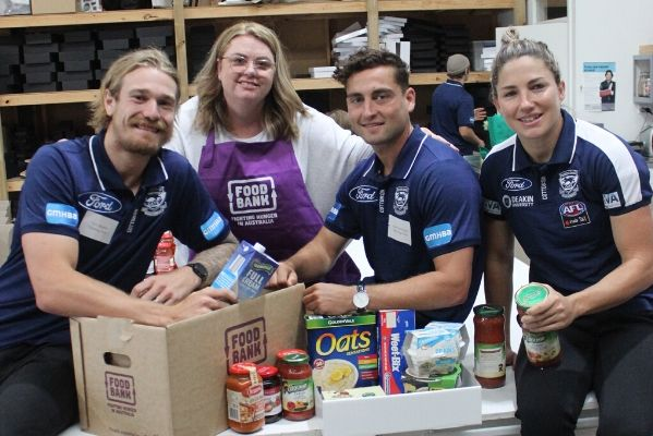 Nicole Newman (second left), who runs The Food Purveyor hamper business, and Geelong Football Club players (from left) Tom Stewart, Luke Dahlhaus and Melissa Hickey