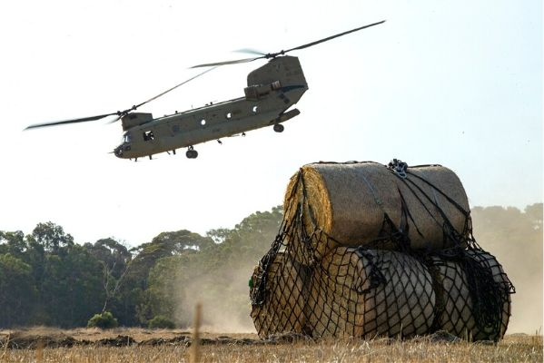 An Australian Army CH-47 Chinook delivers hay to a remote fire-affected farm. Image courtesy of Australian Defence Force Image Gallery