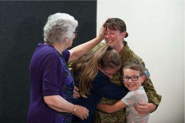 Corporal Marie Yorston reunited in Ballarat with her niece Allee, nephew Brody and Sue Yorston (grandmother), after a month away working in Victoria's Gippsland region. Image courtesy of Australian Defence Force Image Gallery