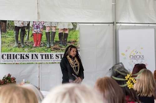 Dja Dja Wurrung woman Rebecca Phillips stands in front of audience at Chicks in the Sticks event
