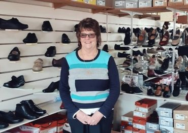 Janice Rowley stands in front of rows of shoes in her Morwell shoe shop