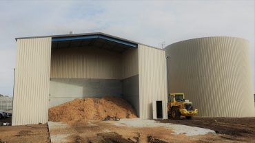Biomass storage shed
