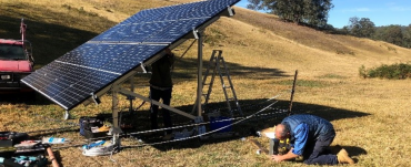 Solar panel used for pumping with man working on it