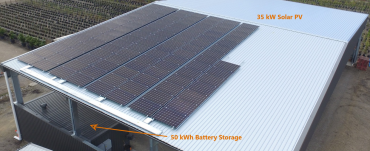 Aerial image of a large shed with a large solar array