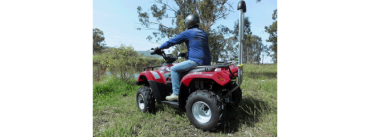 Quad bike with barrier